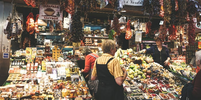 French food market filled with abundant fruits, vegetables, meats and cheeses. Many great choices for a healthy eating plan.